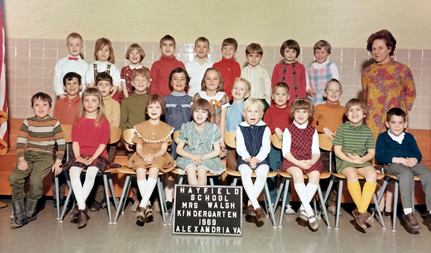 Color class photograph from the 1968 to 1969 school year showing some of the first kindergarteners enrolled in our school and in FCPS. 25 children are pictured, an even mix of boys and girls, and their teacher, Mrs. Walsh is standing behind them on the right.
