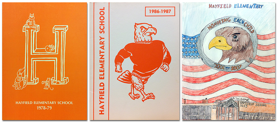Collage showing the covers of three Hayfield Elementary School yearbooks. On the left is the cover of the 1978 to 1979 yearbook. It is an orange cover with a three-dimensional letter H printed in white, and small cartoon figures of an owl, a dog, and a mouse. At center is the cover of our 1986 to 1987 yearbook. It is a white cover with an illustration of our mascot, the hawk, printed in orange. On the right is the cover of our 2006 to 2007 yearbook. It features a full-color student-drawn illustration of a hawk inside a circle. The circle has text that reads: Honoring each child. The circle is set above an American flag. Beneath the flag is an illustration of the front of our building.